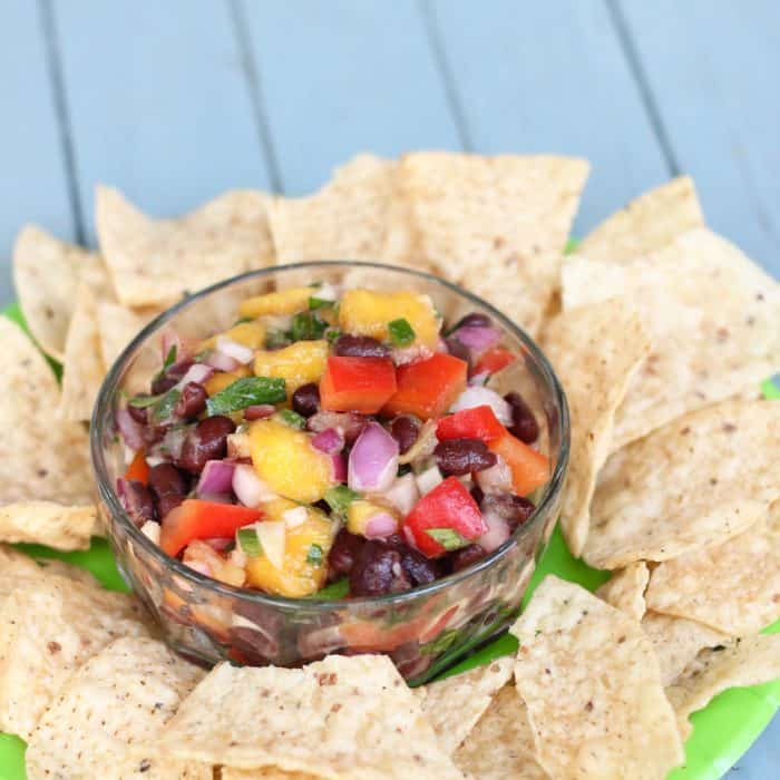 Mango Black Bean Salsa from Living Well Kitchen is gluten-free & vegan and makes everything taste tropical. It's great as a dip or over cooked chicken breast or fish!