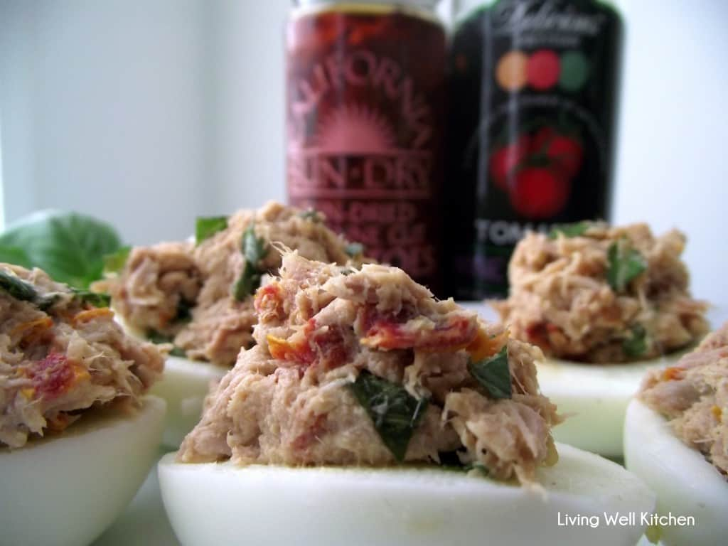 Sun-dried Tomato Tuna Salad in Eggs is a great high protein lunch or snack. Also great as a nourishing appetizer! from Living Well Kitchen @memeinge