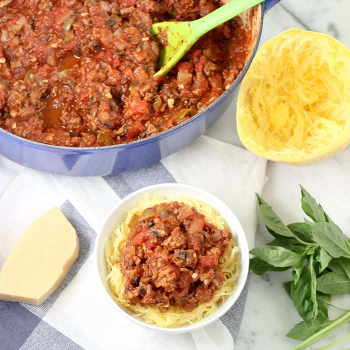 bowl of Turkey Meat Sauce with spaghetti squash, parmesan cheese, and basil