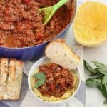 bowl of Turkey Meat Sauce with spaghetti squash, basil, and garlic bread