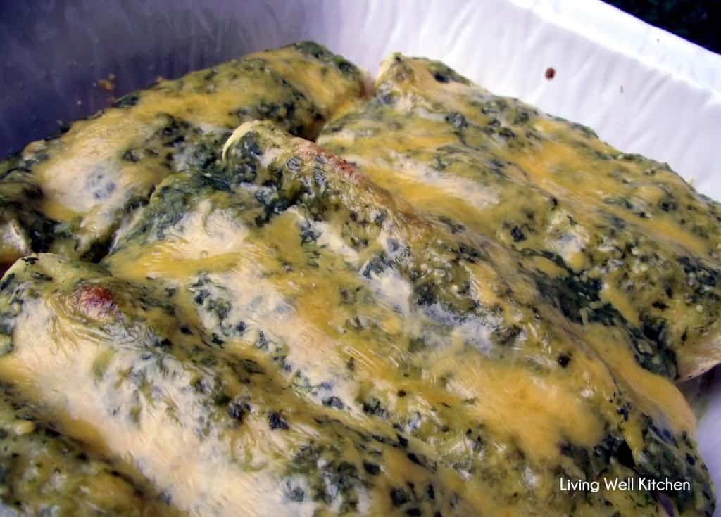 These Beef Enchiladas with Salsa Verde from Living Well Kitchen are completely homemade with a delicious salsa made from tomatillos, jalapeños, and cilantro