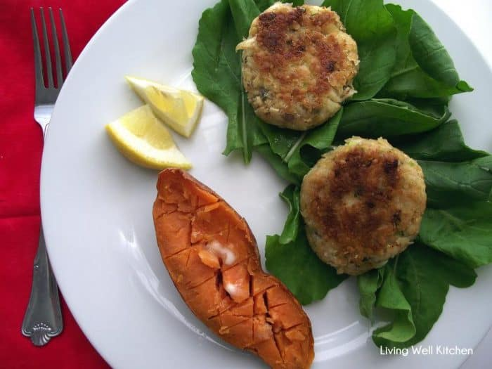 crab cakes over lettuce with lemon slices and sweet potatoes with butter