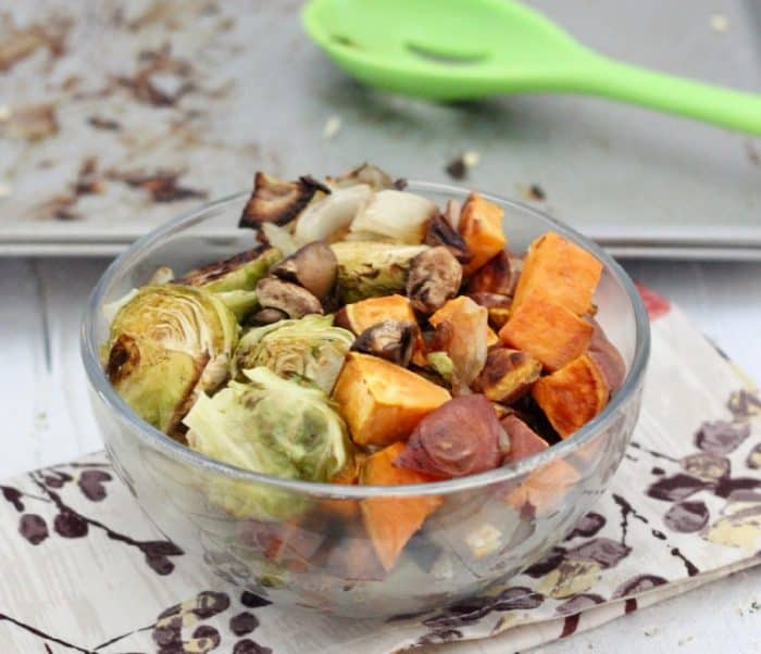 bowl of Thanksgiving Roasted Veggies with baking sheet in background