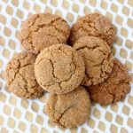 pile of ginger cookies on a gold and white napkin