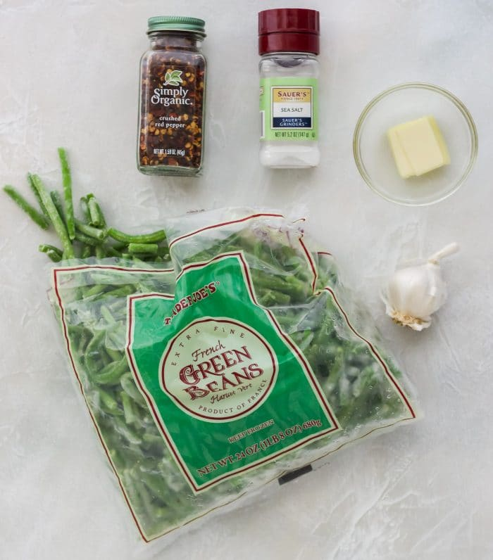 frozen green beans in package, fresh garlic, butter, salt, red pepper flakes