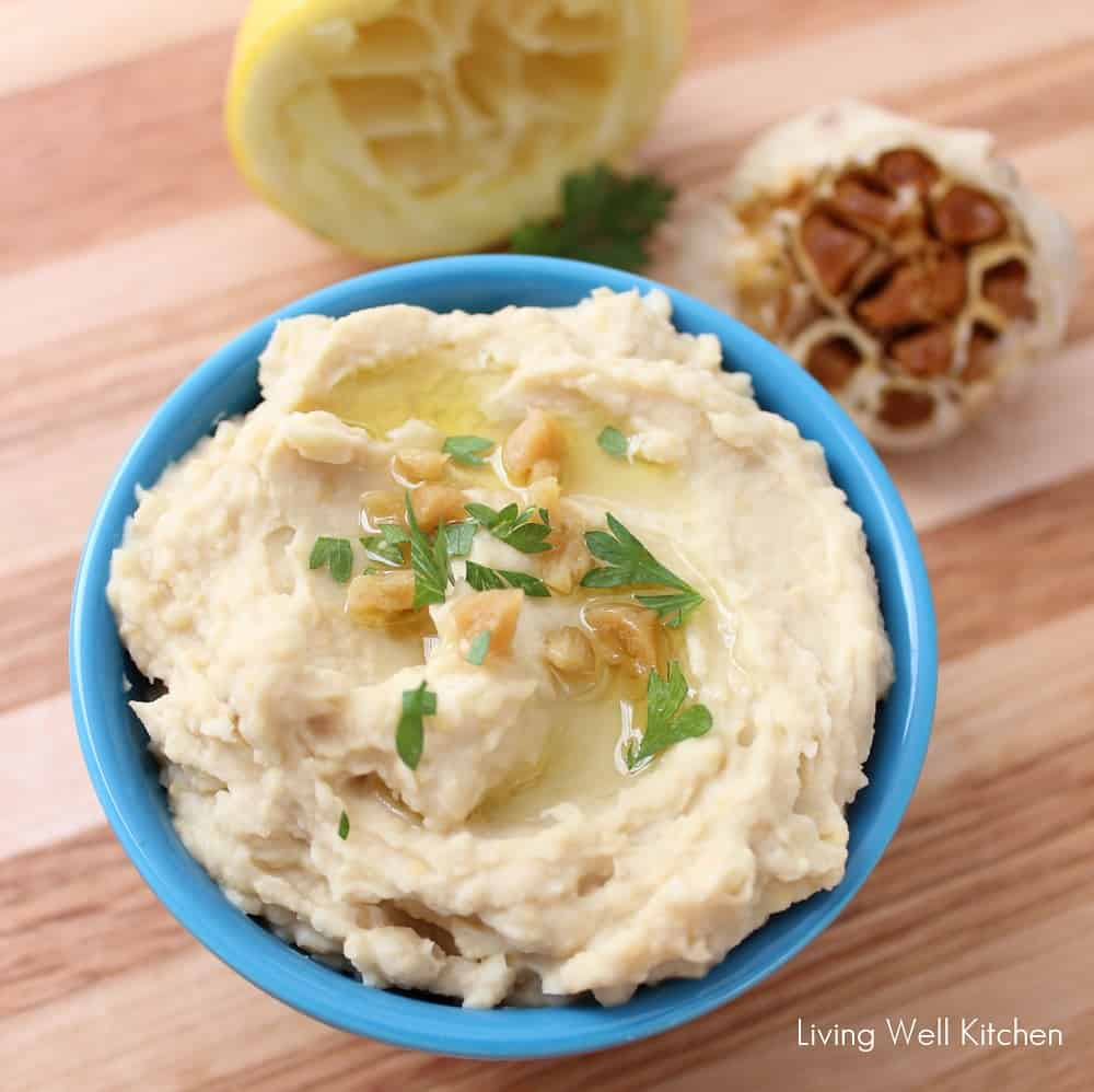 With half the calories of store-bought hummus, this version is still bursting with roasting garlic flavor. Roasted Garlic Hummus recipe from @memeinge is a healthy gluten free, vegan appetizer, snack, or dip