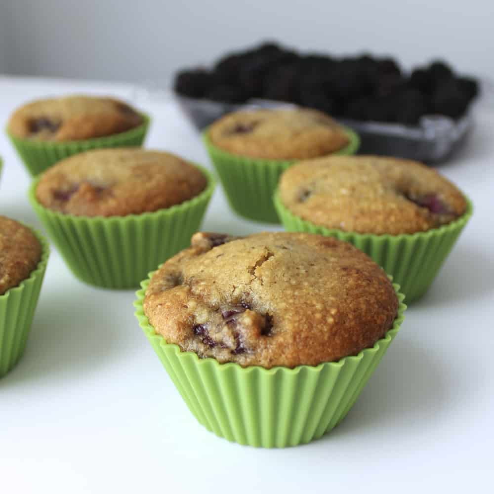 Blackberry Almond Muffins on white table