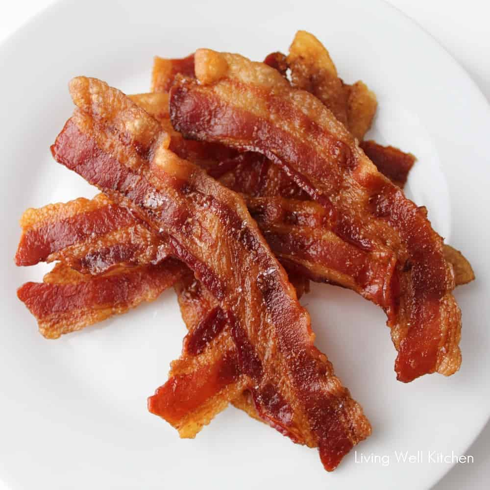 oven baked bacon on white plate