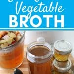 vegetable broth in glass jar with spoon, small glass jars, and broth draining into glass measuring cup