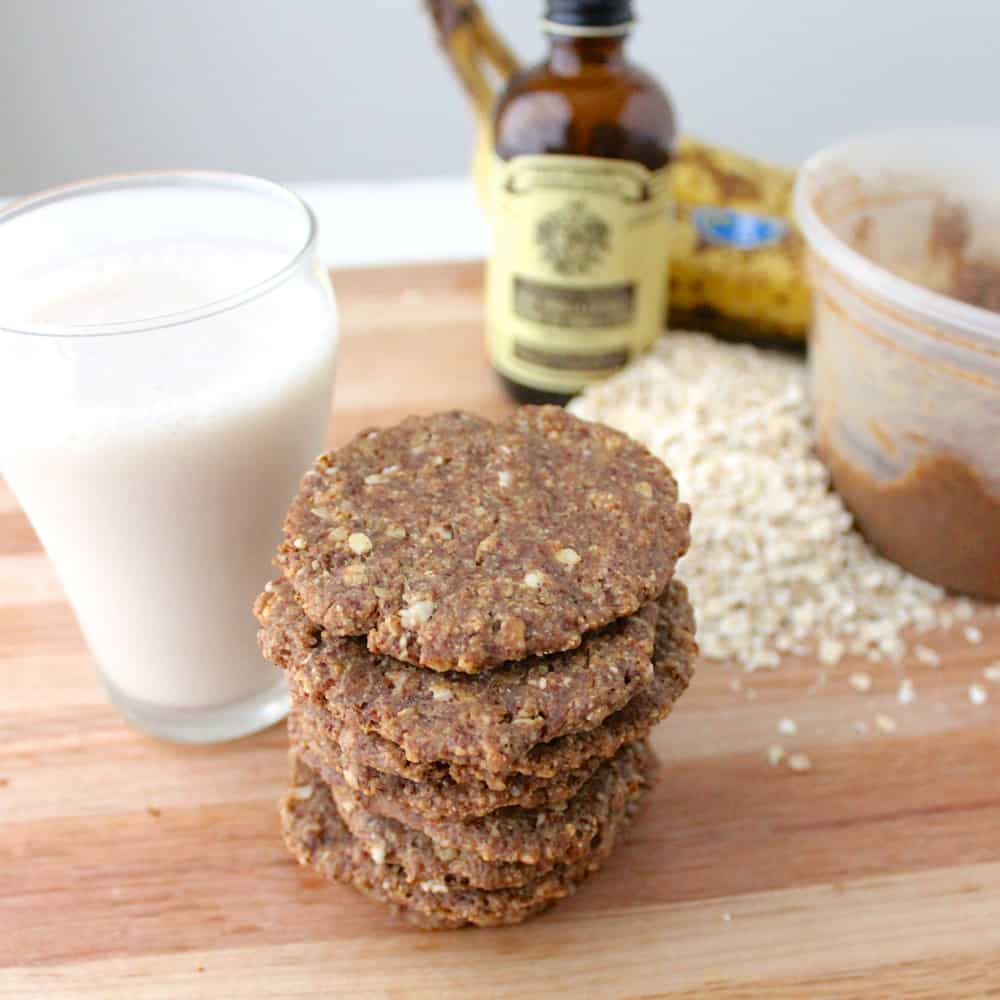 stack of Almond Butter Banana Cookies with milk