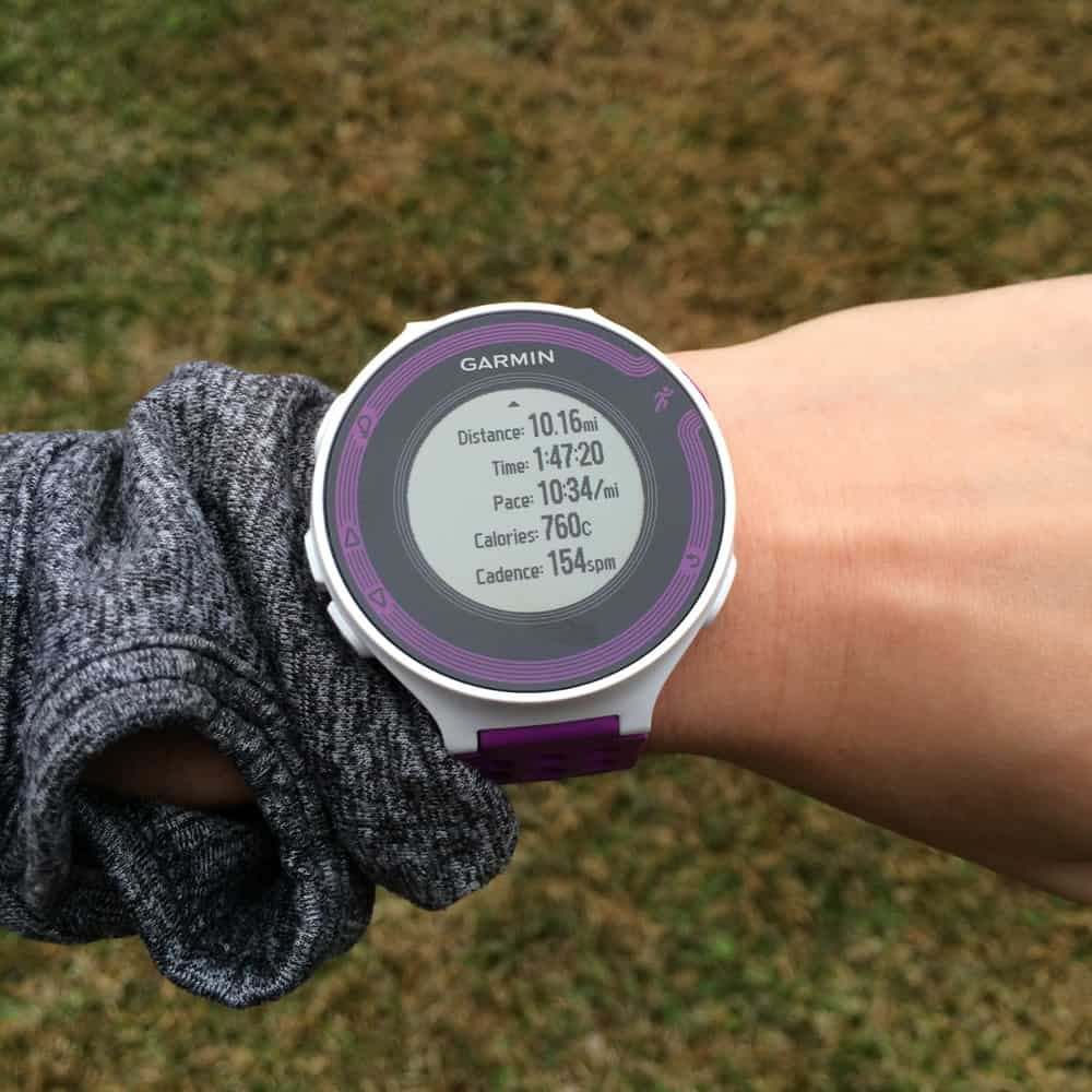 Garmin Forerunner 220 on wrist with data from a run