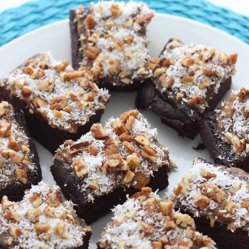 German Chocolate Brownies are black bean brownies sweetened entirely with dates topped with caramel, coconut, and pecans. Heaven!