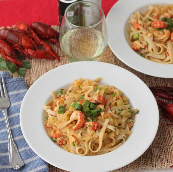 bowls of crawfish Monica with wine