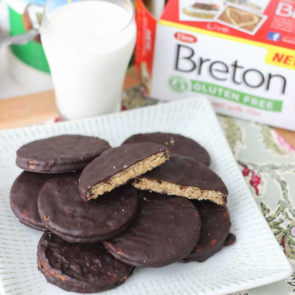 Dangerously easy-to-make gluten-free Almond Butter Cracker Sandwich Cookies coated in chocolate ~ Chocolate Covered Almond Butter Cracker Cookies from Living Well Kitchen