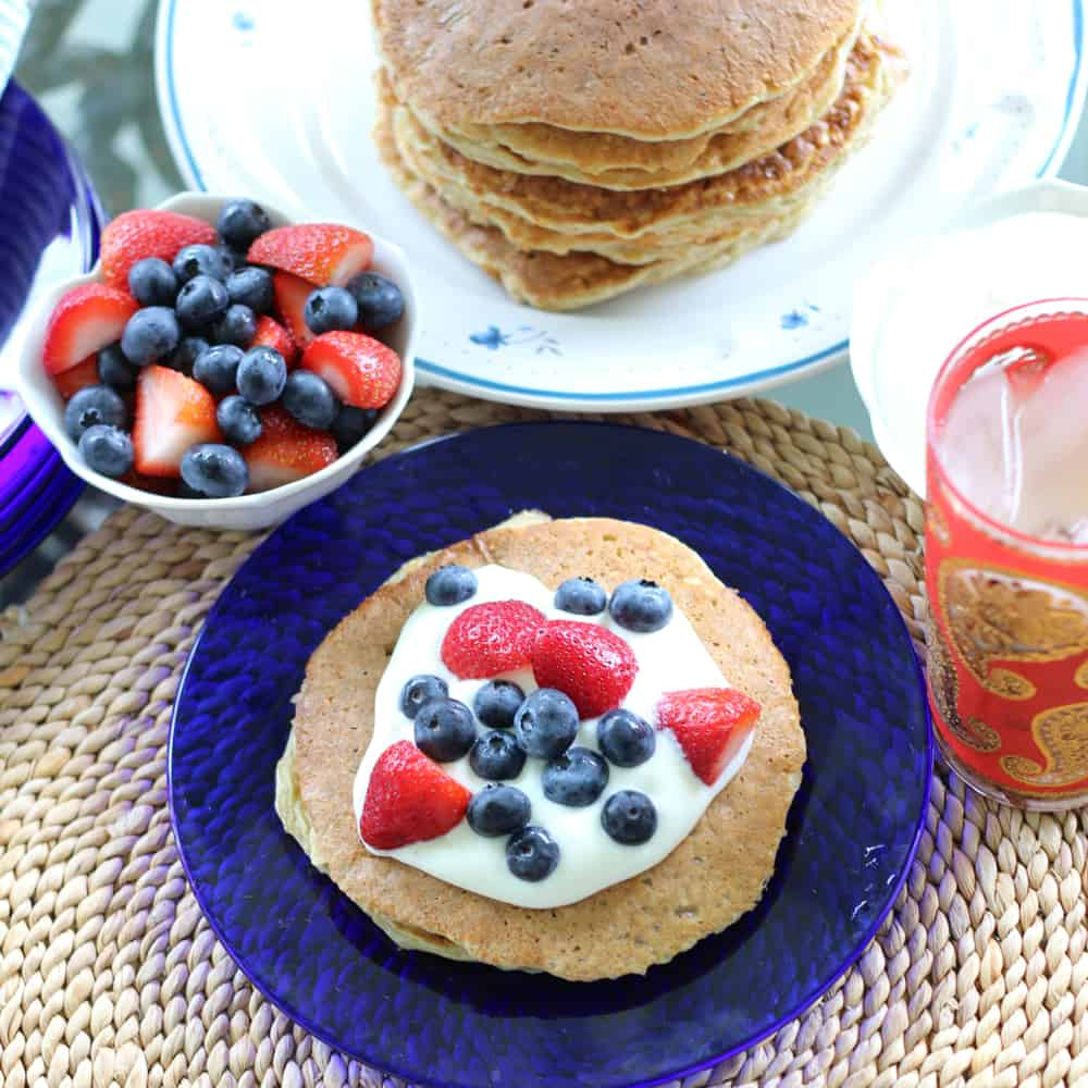 Berries and cream protein pancakes that are both festive and delicious; great for a healthy summer breakfast!