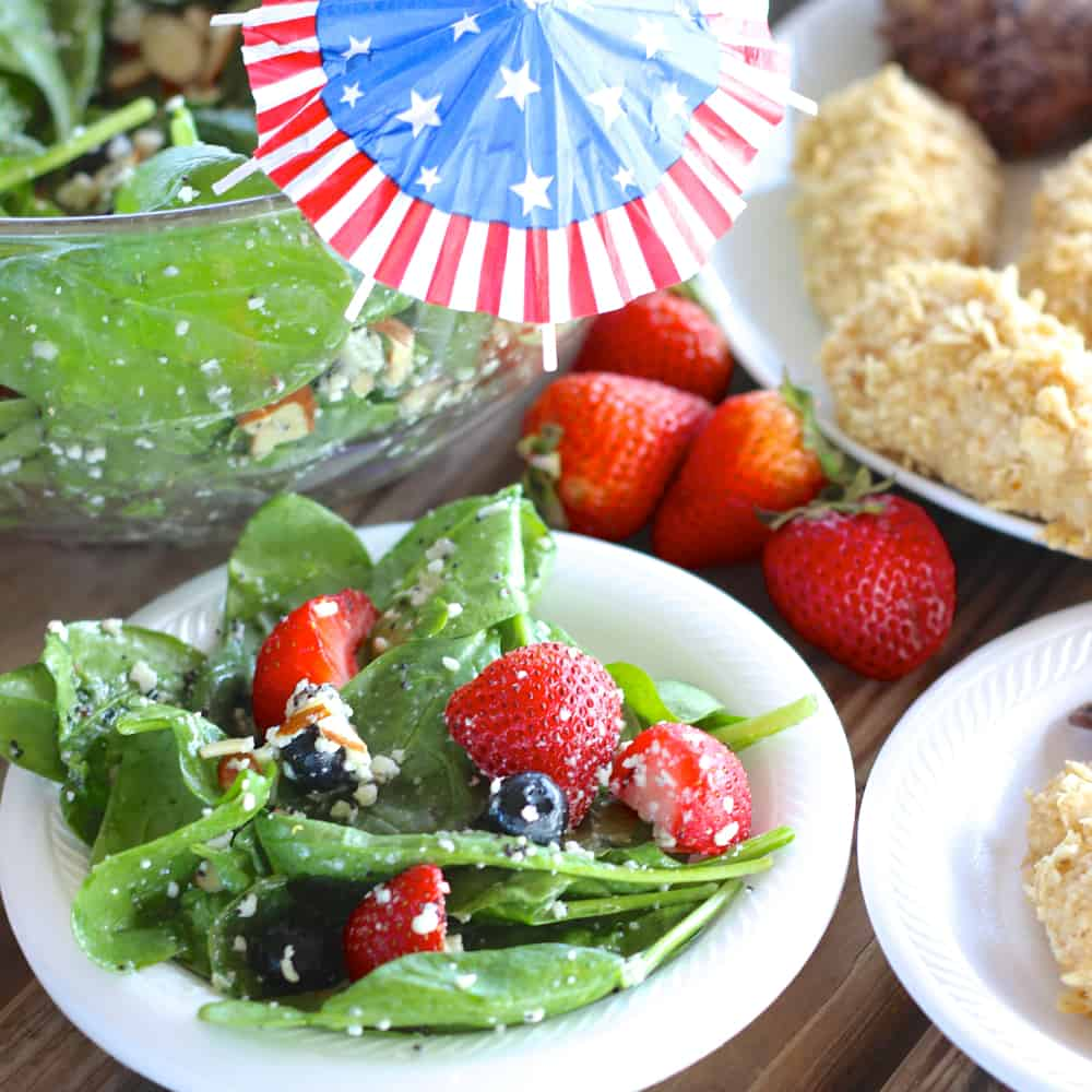 Red white & blue salad that isn't just for the 4th. Yummy toppings and poppyseed dressing make you excited to eat salad!