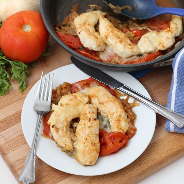 This easy and delicious dish is the perfect weeknight meal: full of veggies and lean protein, cooked in one pan, and ready in about 40 minutes ~ Mozzarella Chicken and Tomatoes from Living Well Kitchen @memeinge