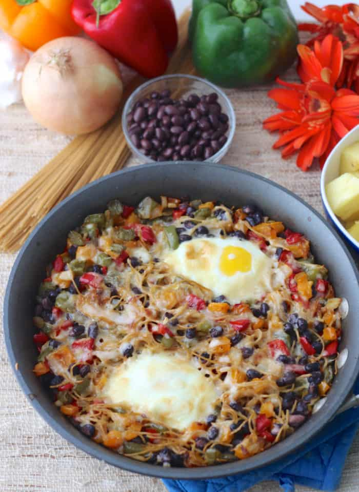 skillet with cooked breakfast pasta, black beans, pasta, and veggies