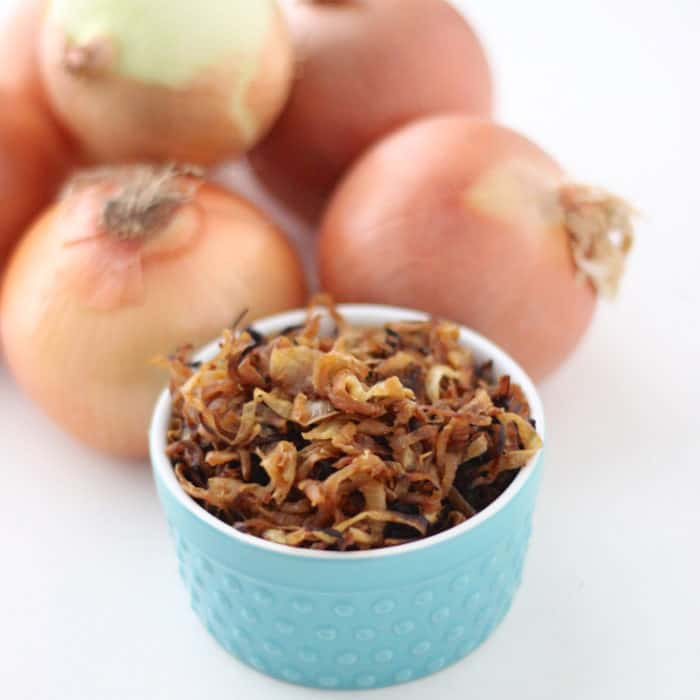 blue bowl of Caramelized Onions and raw onions