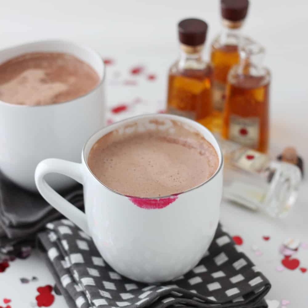 white mug of hot cocoa with lipstick stains