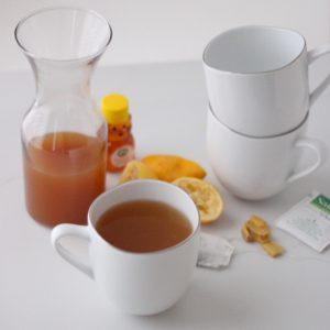 mugs, canister of Ginger White Tea Concentrate, lemon, honey