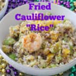 Mardi Gras beads with bowl of multicolored Fried Cauliflower Rice and shrimp