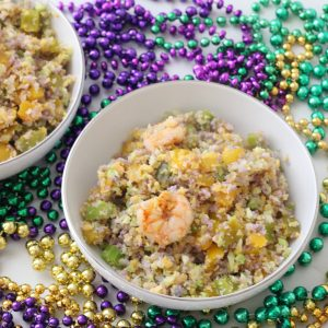 white bowl with Mardi Gras Fried Cauliflower Rice and green, gold and purple beads