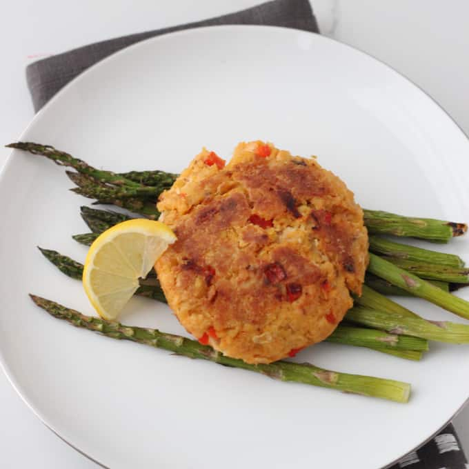 plate of Chickpea Salmon Burger with asparagus and lemon