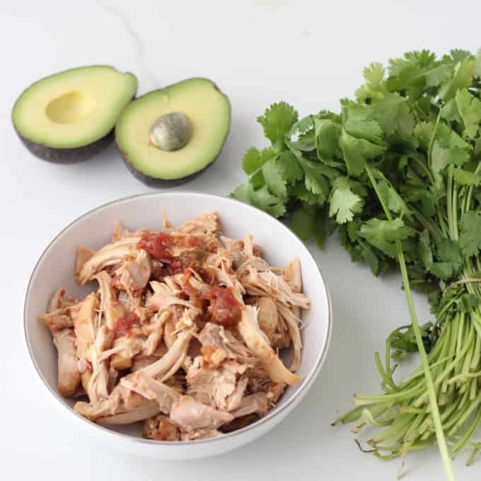bowl of Salsa Chicken with cilantro and avocados