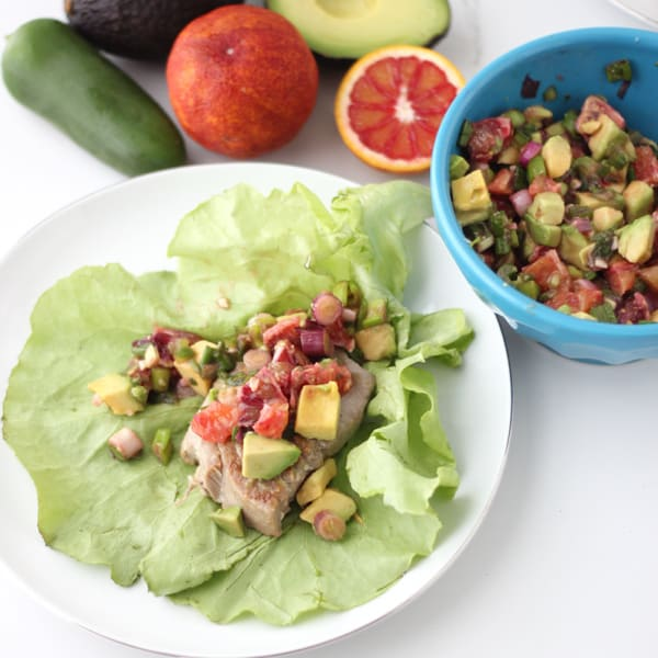 Light and refreshing tuna lettuce wraps with an addicting avocado and blood orange salsa. Tuna Wraps with Avocado and Blood Orange Salsa from Living Well Kitchen