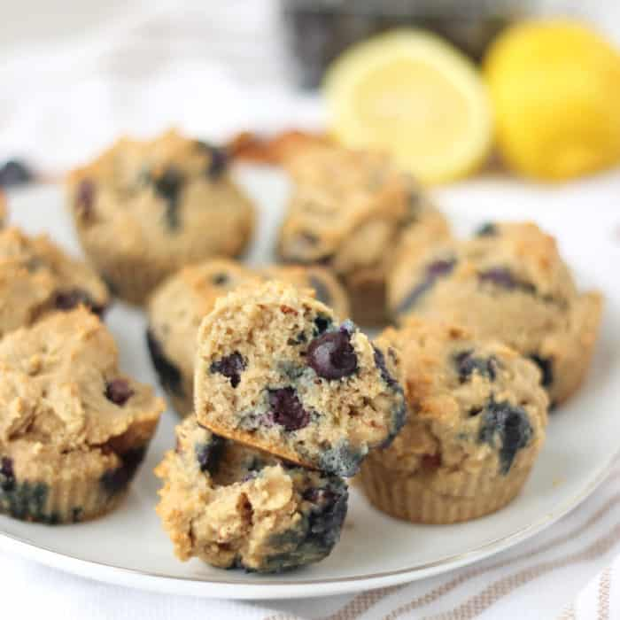 plate of Blueberry Almond Muffins with muffin cut in half to show inside