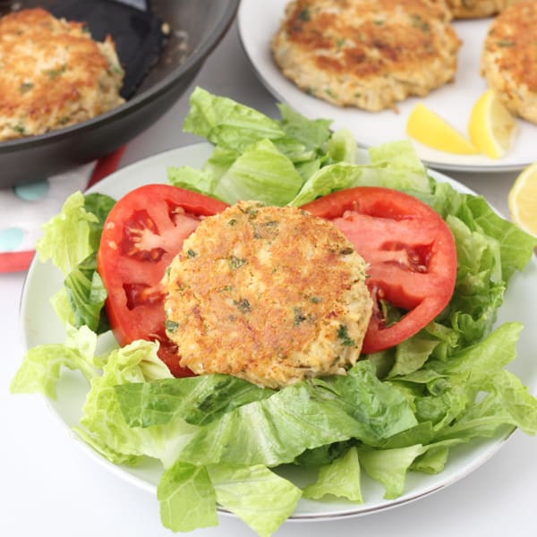 Gluten free Crab Cakes over lettuce with tomatoes