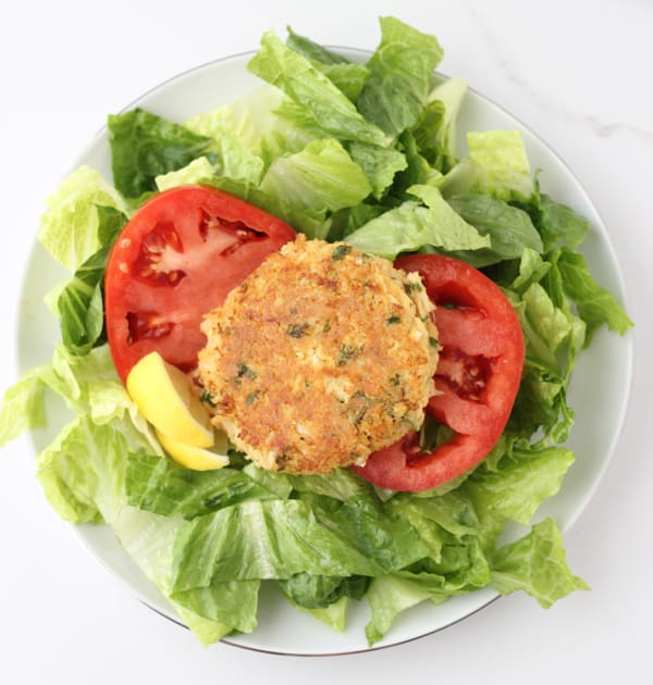 Gluten free Crab Cakes over lettuce and tomatoes