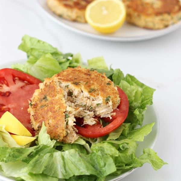 Gluten free Crab Cake broken in half served over lettuce