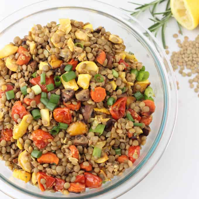bowl of roasted vegetable lentil salad with fresh rosemary and lentils