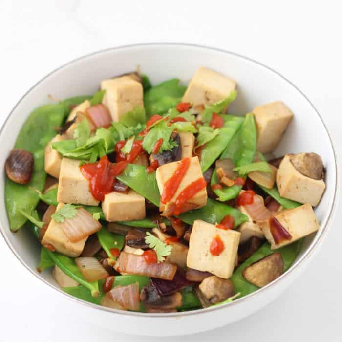 Actually enjoy tofu with this easy & quick dish full of lots of veggies ~ Snap Pea Tofu Stir-fry from @memeinge