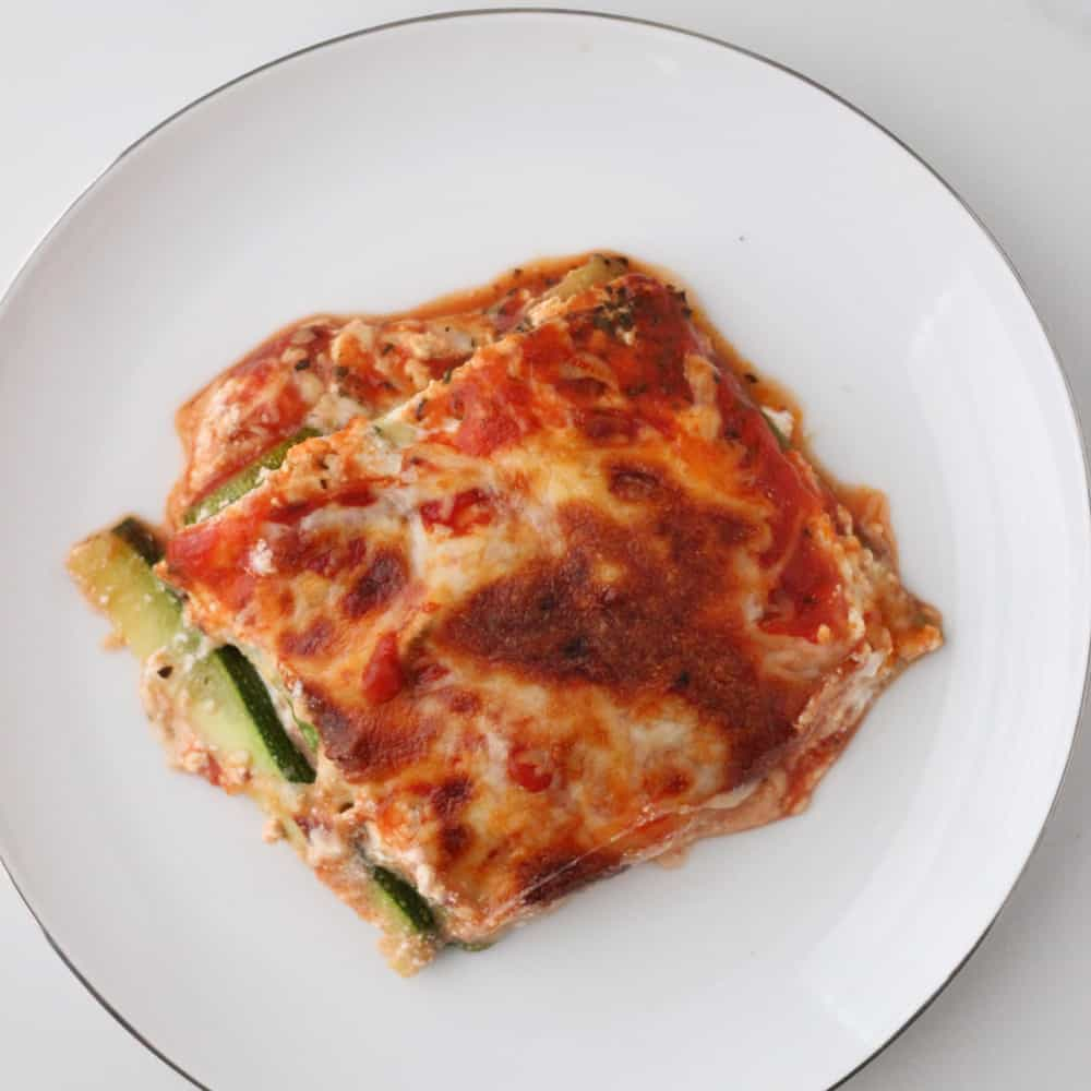 white plate with a slice of zucchini lasagna