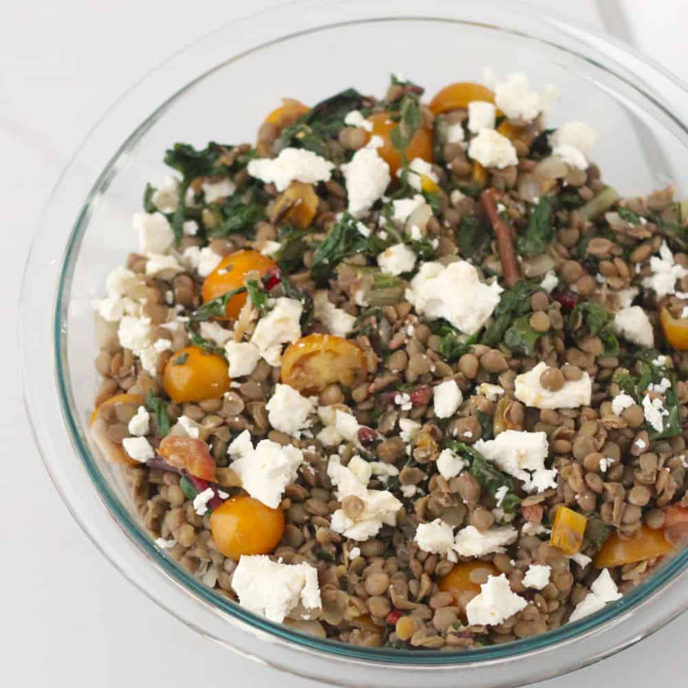 Chard and Feta Lentil Salad has a sweet and spicy dressing complements this giant lentil salad full of late summer veggies - Living Well Kitchen @memeinge