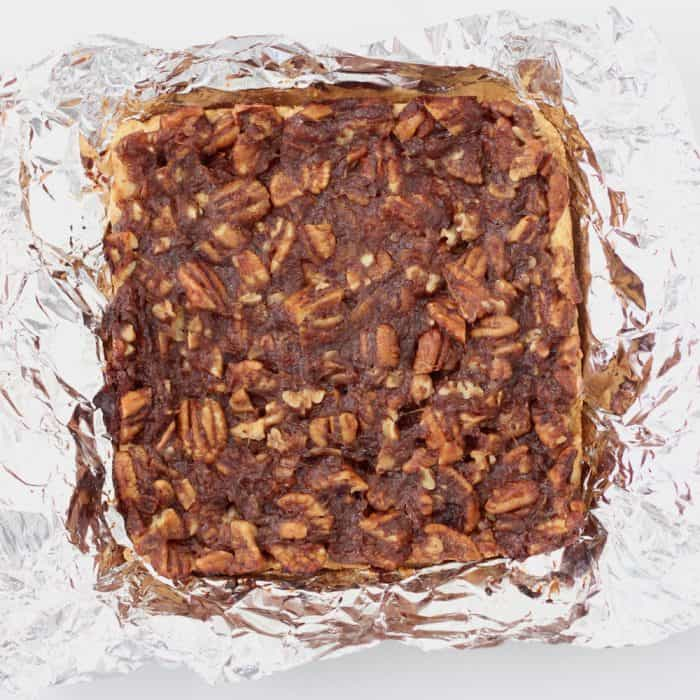 Pecan Pie Bars on foil before being cut into bars