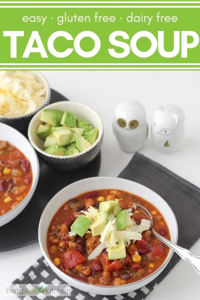 bowl of taco soup with avocados and cheese