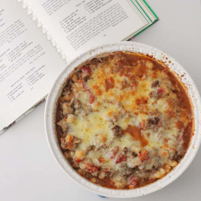 open cookbook and casserole dish with Beef and Hominy Casserole