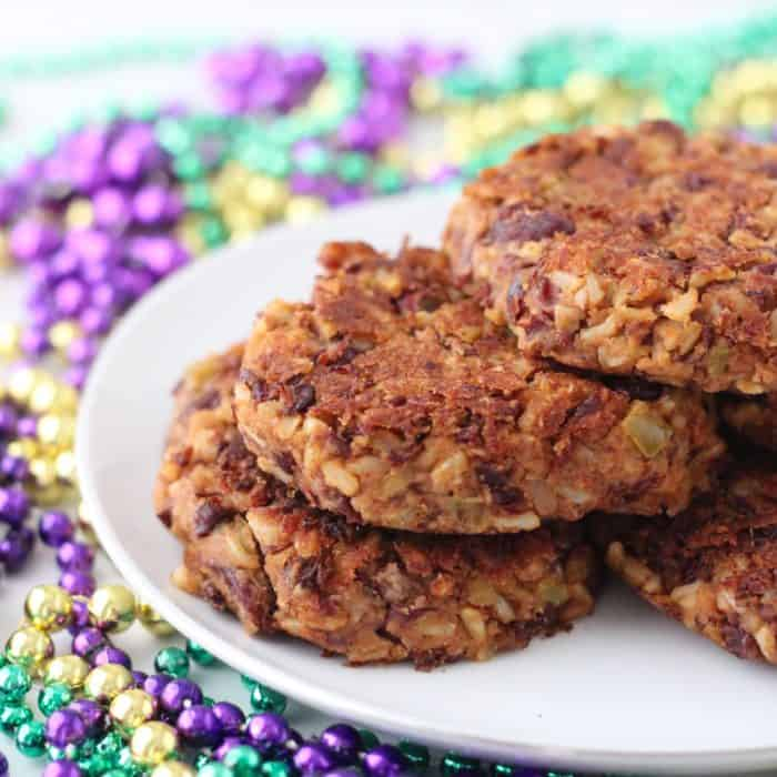 Red Beans and Rice Burger on white plate with Mardi gras beads