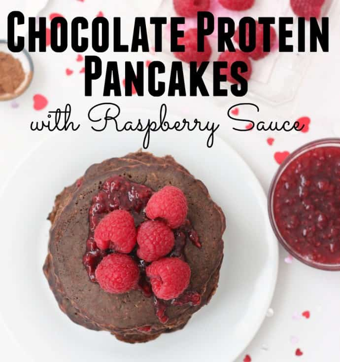 Chocolate Protein Pancakes with raspberries and raspberry sauce with writing on photo