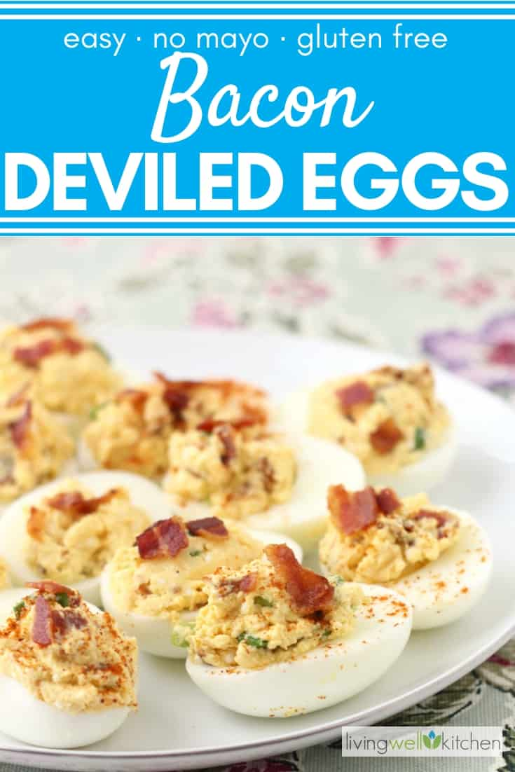 deviled eggs topped with bacon and cayenne pepper on a white plate