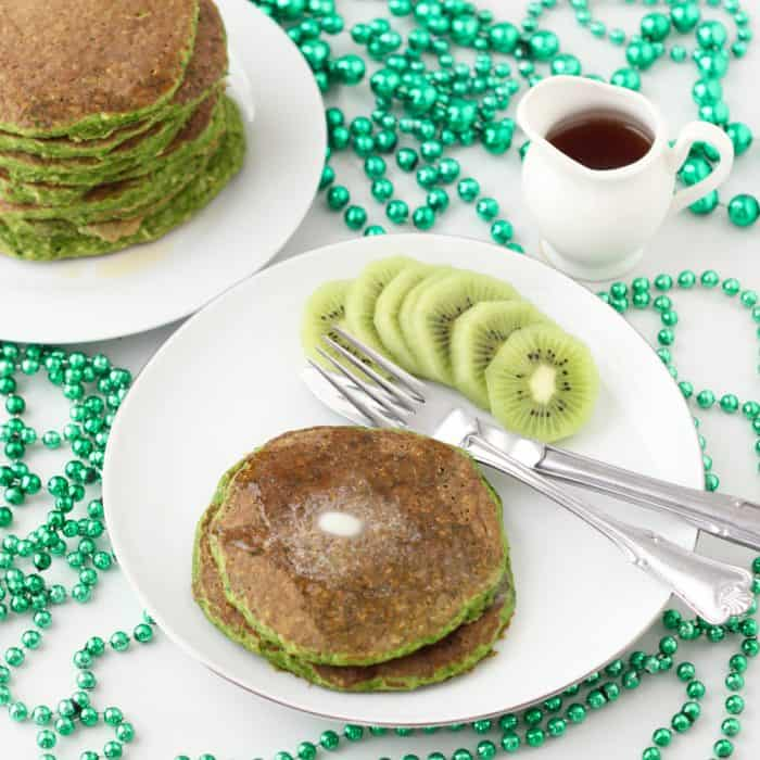 Deliciously festive protein pancakes full of all the good things -- satisfying protein, fiber-filled whole grains, even spinach! These are great any time of year, not just for St. Patrick's Day Festive protein pancakes from Living Well Kitchen @memeinge
