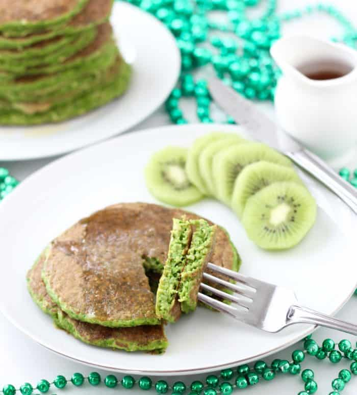 Deliciously festive protein pancakes full of all the good things -- satisfying protein, fiber-filled whole grains, even spinach! These are great all year long, not just for St. Patrick's Day. Festive protein pancakes from Living Well Kitchen @memeinge