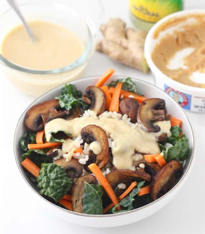 Enjoy a bowl of goodness filled with nourishing kale, filling brown rice, crispy sautéed mushrooms, and sliced carrots all covered in a tasty miso dressing. Miso Brown Rice and Kale Bowl from @memeinge