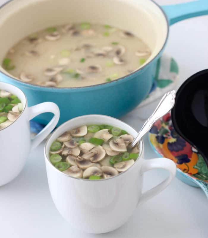 mugs of Miso Soup with pot of soup and spoon