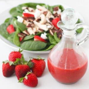 fresh strawberries, bottle of strawberry vinaigrette, spinach salad