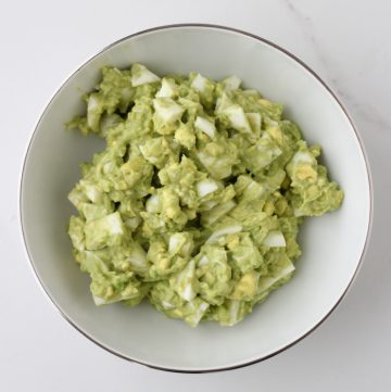 white bowl with avocado egg salad